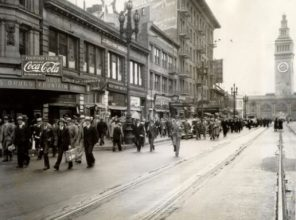 """Commuters and tourists arriving on the ferry walk up Market Street on July 16, 1934 in the absence of streetcar service during the """"Big Strike."""" Photo: San Francisco History Center, San Francisco Public Library"""