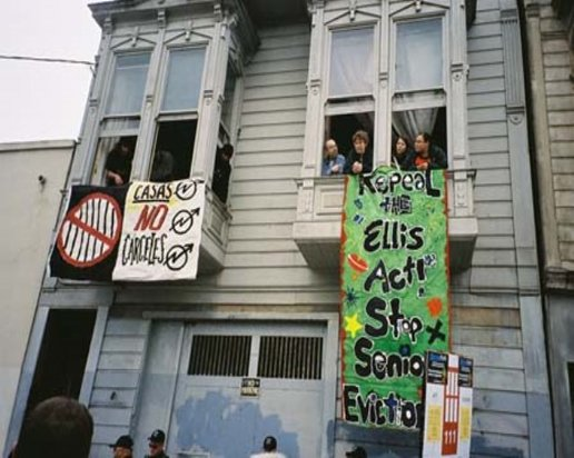 Ted Gullicksen and Sister Bernie Galvin (2nd window from right) at Homes Not Jail occupation