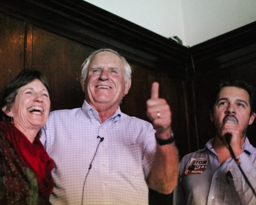 Tom Butt (center), with his wife and campaign manager Alex Knox, reacts as unofficial election results show him winning Richmond's mayoral seat. (Photo by Bonnie Chan)