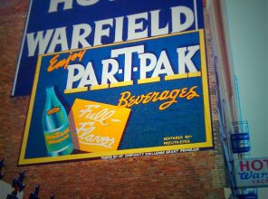Restored historic mural on side of Warfield Hotel, Turk and Taylor