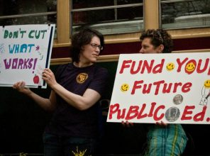 Demonstrators hold signs during a public school funding rally in Philadelphia.  (Photo: kristina dymond/flickr/cc)