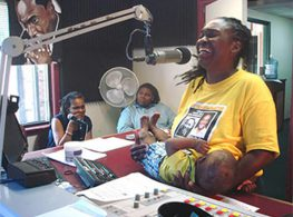 A mother nurses her baby while talking about welfare reform on local public radio, 2014, Selma, Alabama. (Photo courtesy of Kathleen Veit)