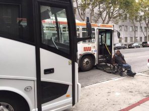 Shuttle blocks man in wheelchair boarding MUNI bus