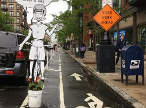 Comic characters in Boston's bike lanes remind drivers (and the mayor) that more can be done to improve safety. Photo: Jonathan Fertig